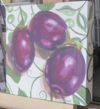 Eggplants on a Green and White Tablecloth